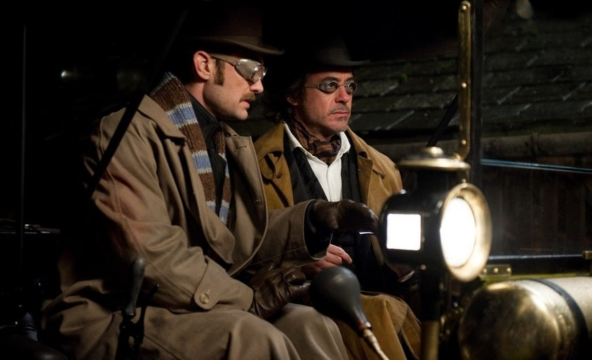 Holmes and Watson wearing steampunk outfit and goggle